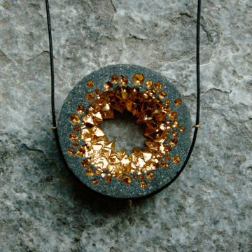 Yowah circular gold statement necklace